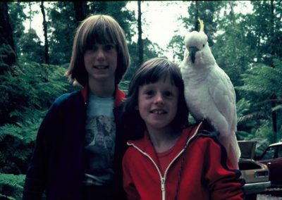 2 girls and a cockatoo. This photo is a bit dark and is an example of editing at Simmy D Photo books