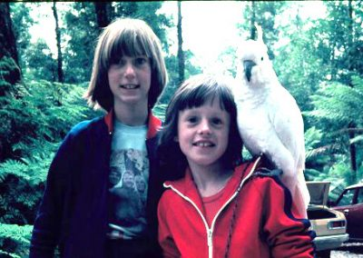 2 girls with a cockatoo. editing example the photo has been lightened