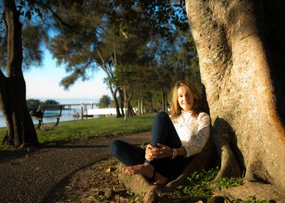 photo of a lady leaning on tree, editing example